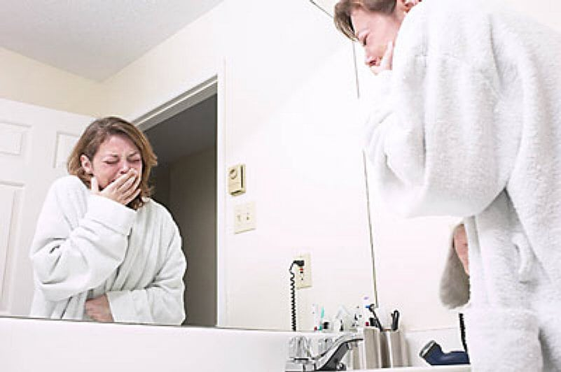 Woman crying at bathroom mirror uid 1343041